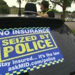 Police seizing cars